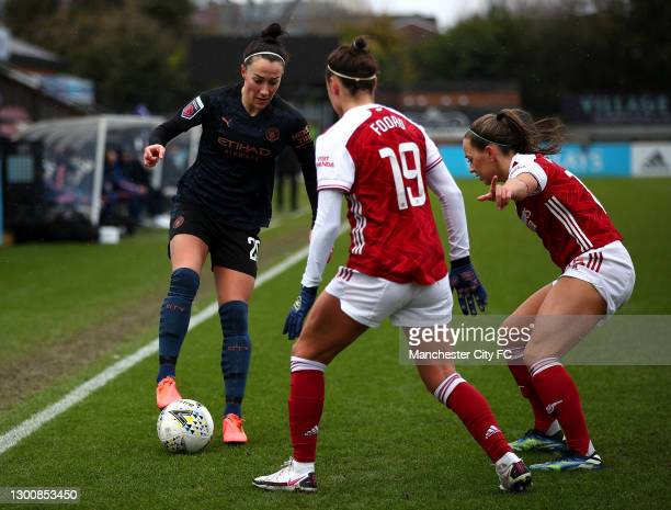 Lucy Bronze of Manchester City takes on Caitlin Foord of Arsenal and Katie McCabe of Arsenal during the Barclays FA Women's Super League match...