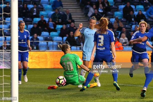 Lucy Bronze of Manchester City Women scores past Ann-Katrin Berger of Birmingham City Ladies during the WSL 1 match between Manchester City Women and...