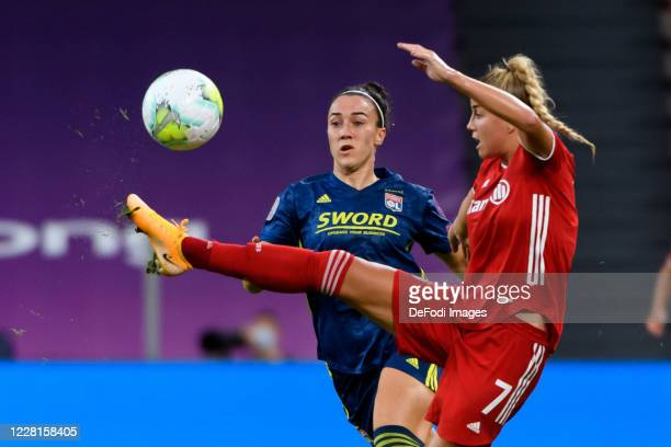 Lucy Bronze of Olympique Lyon and Giulia Gwinn of Bayern Muenchen battle for the ball during the UEFA Women's Champions League Quarter Final match...