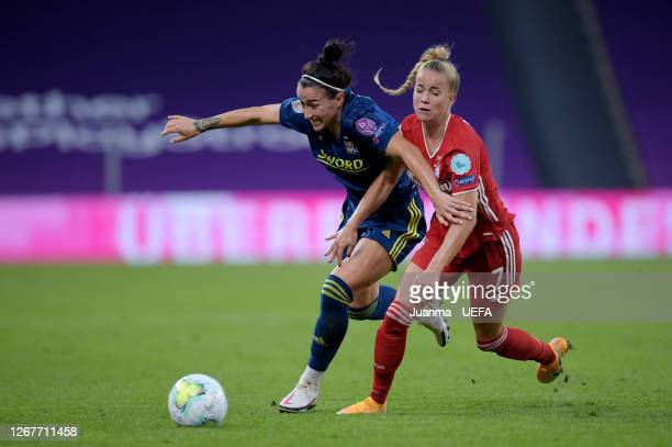 Lucy Bronze of Olympique Lyon battles for possession with Giulia Gwinn of FC Bayern Munich during the UEFA Women's Champions League Quarter Final...