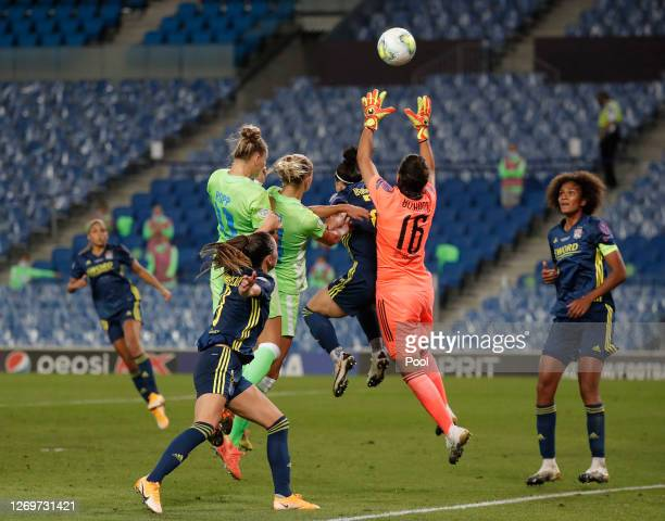 Lucy Bronze of Olympique Lyon collides with Sarah Bouhaddi of Olympique Lyon as they compete for the ball during the UEFA Women's Champions League...