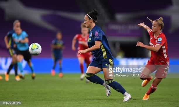 Lucy Bronze of Olympique Lyon is challenged by Giulia Gwinn of FC Bayern Munich during the UEFA Women's Champions League Quarter Final match between...