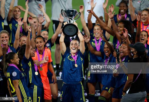 Lucy Bronze of Olympique Lyon lifts the UEFA Women's Champions League Trophy following her team's victory in the UEFA Women's Champions League Final...