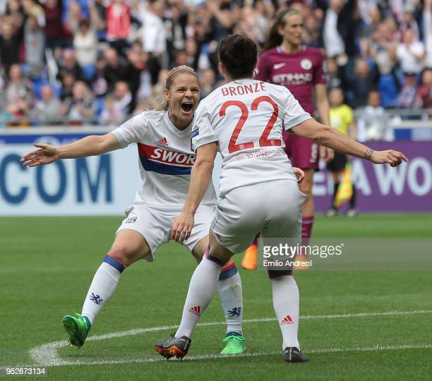 Lucy Bronze of Olympique Lyonnais celebrates with her teammate Ada Hegerberg after scoring the opening goal during the UEFA Women's Champions League...