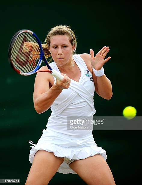 Lucy Brown of Great Britain in action during her first round girl's match against Ashley Barty of Australia on Day Seven of the Wimbledon Lawn Tennis...