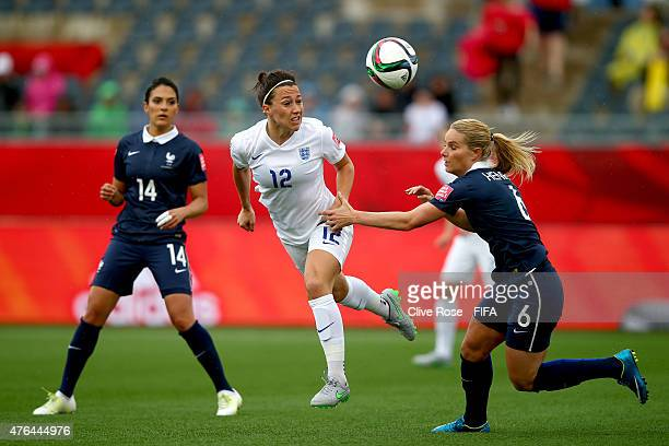 Lucy Broze of England is challanged by Amandine Henry of France during the FIFA Women's World Cup 2015 Group F match between France and England at...