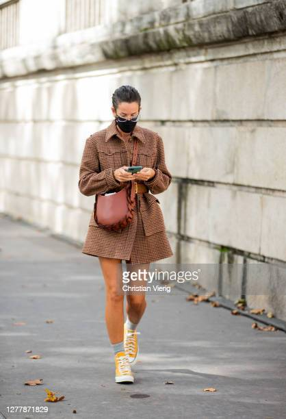 Lucy Chadwick is seen wearing brown jacket, bag outside Chloe during Paris Fashion Week - Womenswear Spring Summer 2021 : Day Four on October 01,...