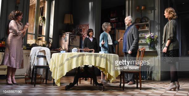 Lucy Cohu Amanda Drew Eileen Atkins Jonathan Pryce and Anna Madeley pose at a photocall for 'The Height Of The Storm' at Wyndhams Theatre on October...