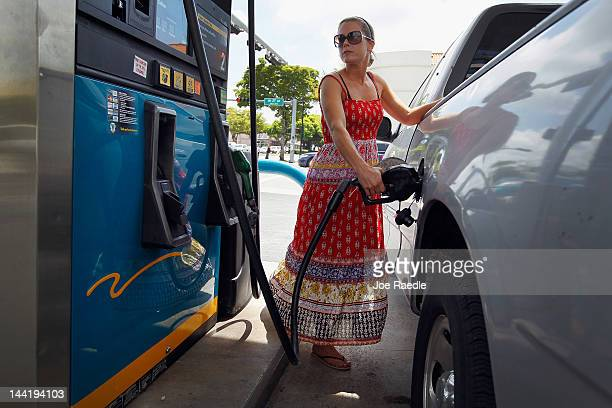 Lucy Crawford puts gas into her vehicle at a Valero station on May 11 2012 in Miami Florida Reports indicate that gasoline prices have dropped 5...