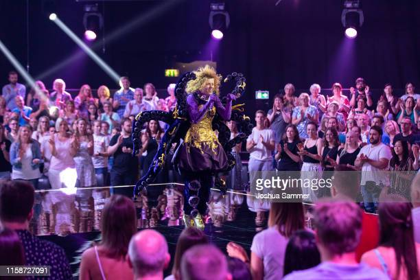 Lucy Diakovska performs on stage during the first liveshow of The Masked Singer at Coloneum on June 27 2019 in Cologne Germany