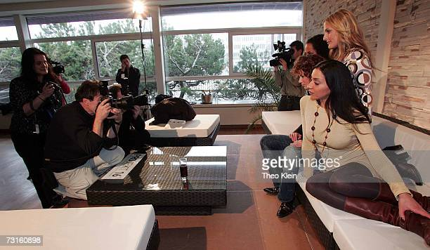Lucy Diakovska, Sandy Moelling, Jessica Wahls and Nadja Benaissa pose for photographs at a press conference to announce the reunion of German pop...