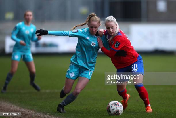 Lucy Fitzgerald of London City Lionesses battles for possession with Ali Johnson of Blackburn Ladies during the Barclays FA Women's Championship...