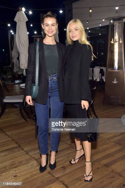 Lucy Fry and Charly Sturm as Cuyana x RAD Host Panel and Dinner in Honor of Future Coalition at The H Club Los Angeles on October 30, 2019 in Los...