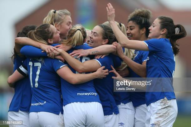 Lucy Graham of Everton celebrates scoring her sides third goal with her team mates during the Barclays FA Women's Super League match between Everton...