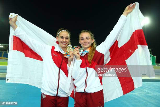 Lucy Hadaway and Holly Mills of England celebrate after winning medals after competing in the Girls Long Jump Final during the Athletics on day 3 of...