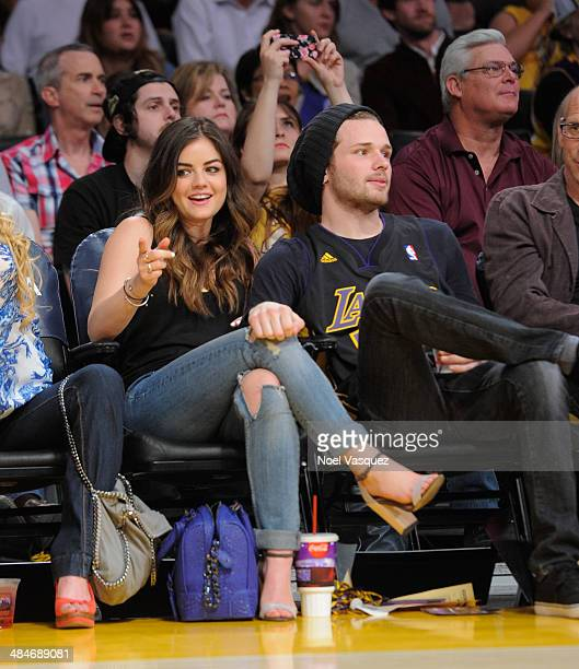 Lucy Hale and Joel Crouse attend a basketball game between the Memphis Grizzlies and the Los Angeles Lakers at Staples Center on April 13, 2014 in...