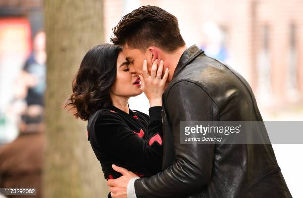 Lucy Hale and Zane Holtz kiss while filming on location for 'Katy Keene' on the streets of Brooklyn on October 2 2019 in New York City