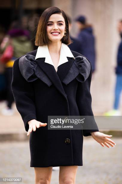 Lucy Hale, wearing a black decorated coat, is seen outside Miu Miu, during Paris Fashion Week - Womenswear Fall/Winter 2020/2021 : Day Nine on March...