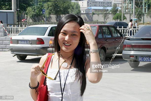 Lucy Hao a jewelry trader who underwent facial surgery last week arrives at a clinic to have stitches removed from her nose and eyes in Beijing on...