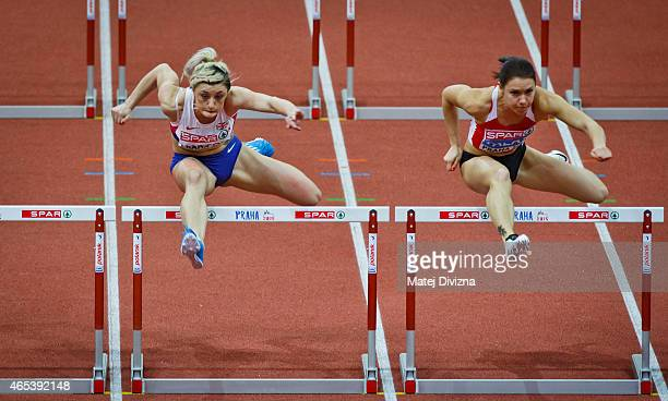 Lucy Hatton of Great Britain and Alina Talay of Italy compete in the Women's 60 metres Hurdles Semifinal during day one of the 2015 European...