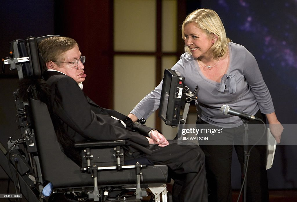 Lucy Hawking (R) touches her father Professor Stephen Hawking (L) as they give a lecture entitled 'Why We Should Go Into Space' during the 50 Years of NASA lecture series at George Washington University in Washington, DC, April 21, 2008. AFP PHOTO/Jim WATSON