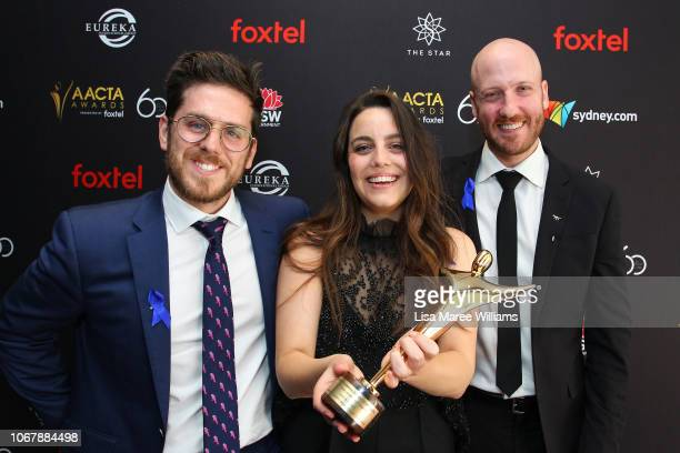 Lucy Hayes, Andrew Goldsmith and Bradley Slabe pose in the media room with the AACTA Award for Best Short Animation for Lost & Found during the 2018...
