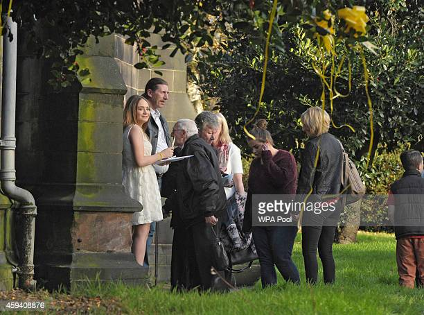 Lucy Henning welcomes family and friends as they arrive for a memorial service for murdered British aid worker Alan Henning at Eccles Parish Church...