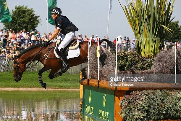 Lucy Jackson of New Zealand rides on Willy Do and falls down during the DHL Price Cross Country Test at Aachener Soers on July 19 2014 in Aachen...