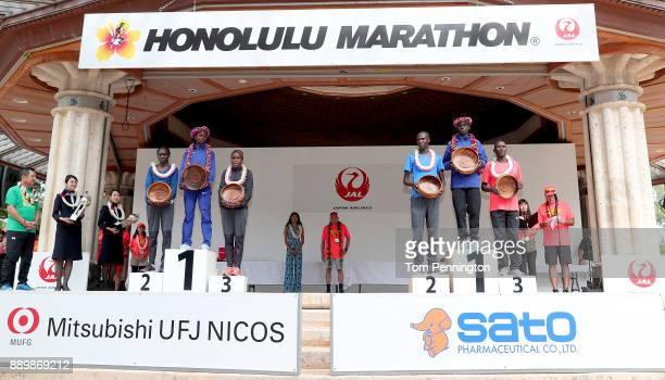 Lucy Karimi of Kenya in second place, Brigid Kosgei of Kenya in first place and Joyce Chepkirui in third place, Lawrence Cherono of Kenya in second...