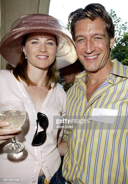 Lucy Lawless and Robert Gant during GLAAD Summer Party Absolut Hancock Park at Private Residence in Los Angeles California United States