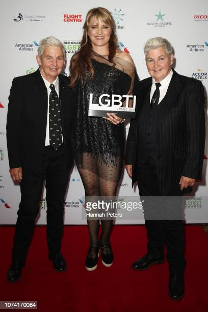 Lucy Lawless poses with her award for Local Icon with Lynda Topp and Jools Topp at the New Zealand LGBTI Awards 2018 at the Cordis Hotel on November...