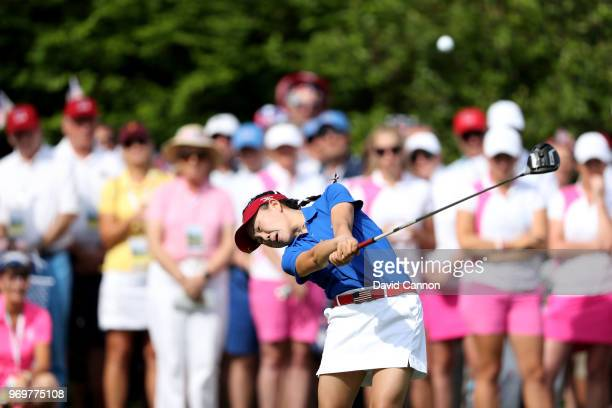 Lucy Li of the United States plays her tee shot on the first hole in her match with Jennifer Kupcho against Sophie Lamb and Olivia Mehaffey of the...