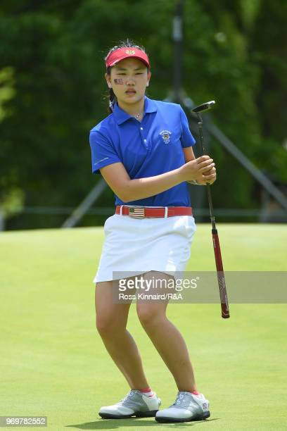 Lucy Li of the United States reacts after a putt on the 14th green during fourball matches on day one of the 2018 Curtis Cup at Quaker Ridge Golf...