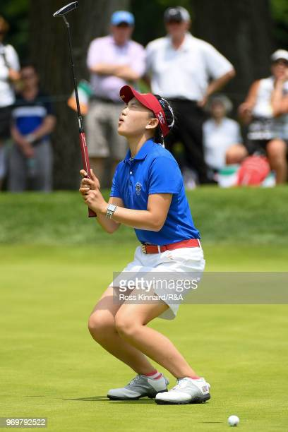Lucy Li of the United States reacts after missing a putt on the 17th green during fourball matches on day one of the 2018 Curtis Cup at Quaker Ridge...