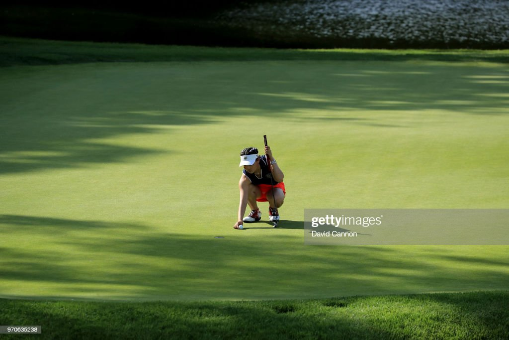 Lucy Li of the United States team lines up a putt on the fifth green in her match with Sophia Schubert in their match against Paula Grant and Shannon McWilliam of the Great Britain and Ireland Team during the afternoon foursomes matches in the 2018 Curtis Cup Match at Quaker Ridge Golf Club on June 9, 2018 in Scarsdale, New York.