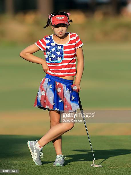 Lucy Li of the USA who is 11 years old waiting to putt on the 12th green during the first round of the 69th US Women's Open at Pinehurst Resort...