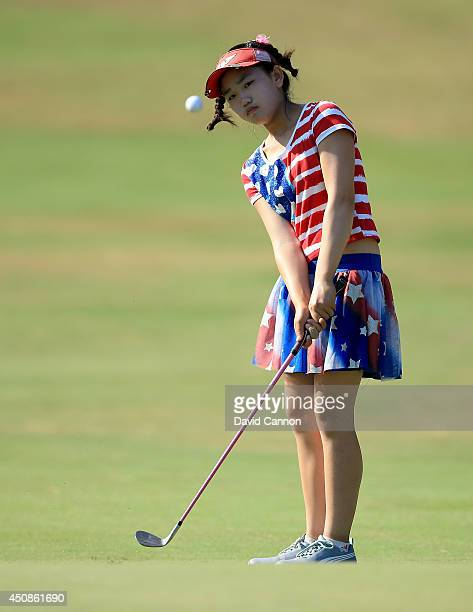 Lucy Li of the USA who is only 11years old plays her fourth shot at the par 4 16th hole during the first round of the 69th US Women's Open at...