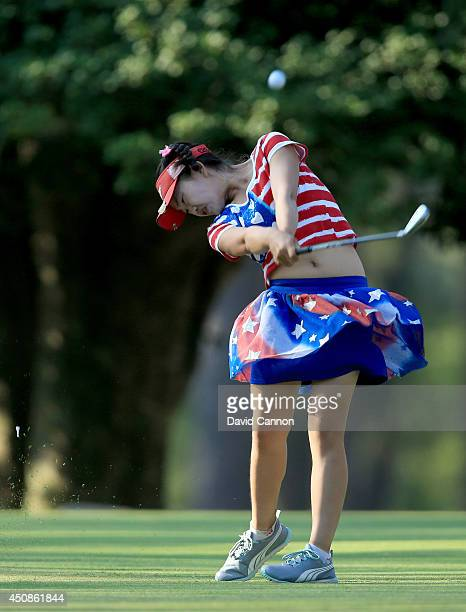 Lucy Li of the USA who is only 11years old plays her tee shot at the par 3 15th hole during the first round of the 69th US Women's Open at Pinehurst...