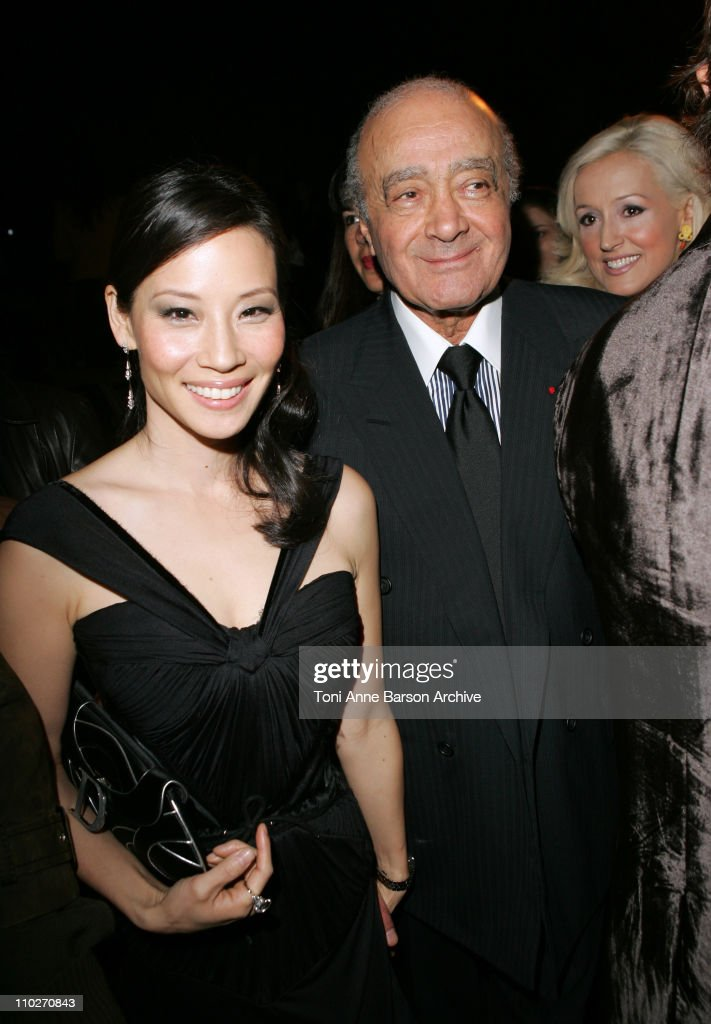 Lucy Liu and Mohamed Al-Fayed during Paris Fashion Week - Pret a Porter Spring/Summer 2006 - Christian Dior - Arrivals at Grand Palais in Paris, France.