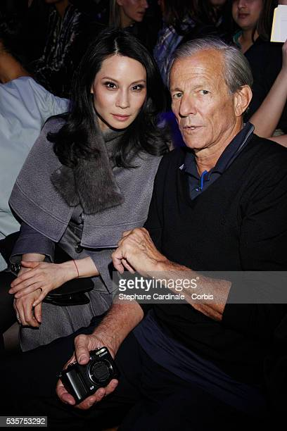 Lucy Liu and Peter Beard at the John Galliano Ready To Wear Fall/Winter 2008/2009 collection show during Paris Fashion Week