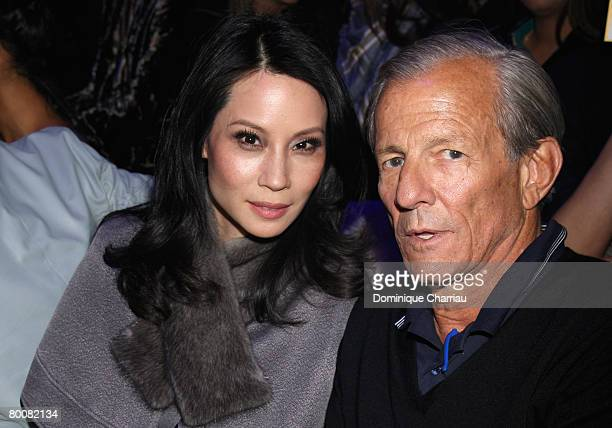 Lucy Liu anf Peter Beard attend the John Galliano fashion show during Paris Fashion Week Fall/Winter 2008 held at the Grande Halle de la Vilette on...