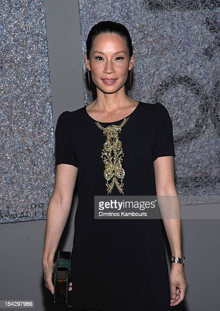 Lucy Liu attends Connecting The Dots Book Launch Exhibition Opening at Donna Karan's Urban Zen Center at the Stephen Weiss Studio on October 17 2012...