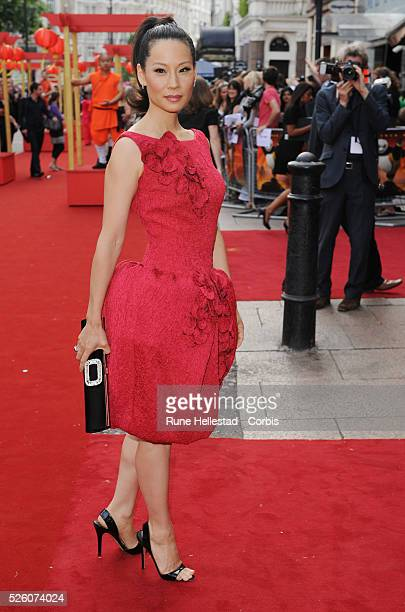Lucy Liu attends the premiere of Kung Fu Panda at the Vue Leicester Square in London Dress by Giambattista Valli shoes by Courtney Crawford clutch by...