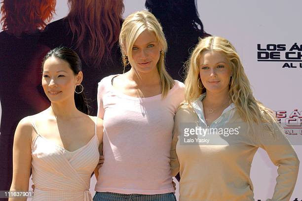 Lucy Liu Cameron Diaz and Drew Barrymore during 'Charlies Angels Full Throttle' Photo Call Madrid at VIlla Magna Hotel in Madrid Spain