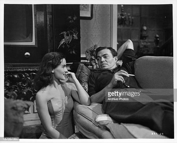 Lucy Marlow sitting beside James Mason on the couch in a scene from the film 'A Star Is Born', 1954.