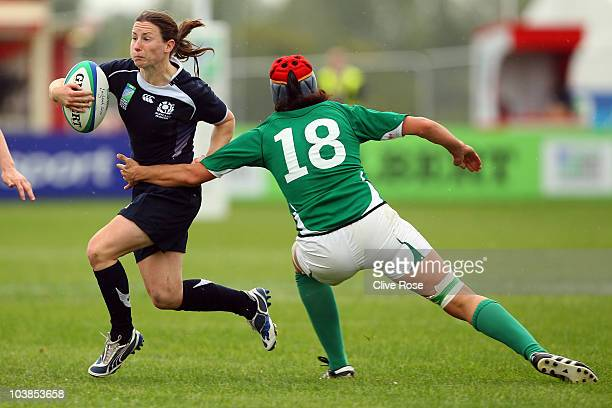 Lucy Millard of Scotland is tackled by Orla Brennan of Ireland during the seventh place Play-Off match between Scotland and Ireland in the IRB...