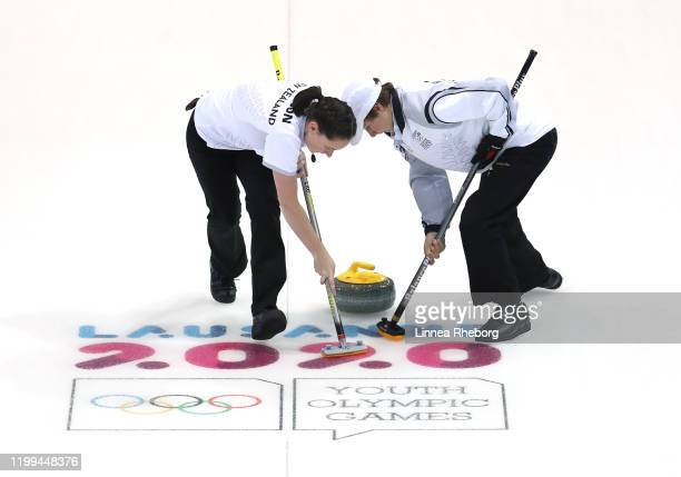 Lucy Neilson and William Becker of New Zealand play a rock in their Mixed Team Round Robin Group C Session 14 match against Great Britain in curling...