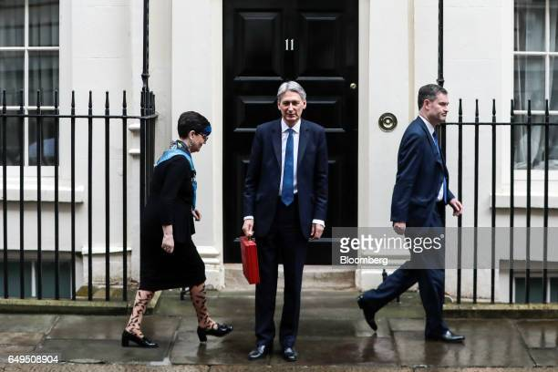 Lucy NevilleRolfe commercial secretary to the UK Treasury left and David Gauke chief secretary to the UK Treasury right leave as Philip Hammond UK...