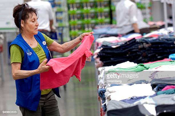 Lucy Nickell refolds a shirt while working in the apparel section of a Sam's Club store the membership warehouse club unit of WalMart Stores Inc in...