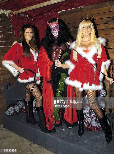"""Lucy Pinder and Michelle Marsh during """"Slay Belles"""" Have Hot Date with Satan - December 8, 2005 at The London Dungeon in London, Great Britain."""